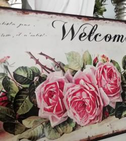 Aflangt skilt med roser...