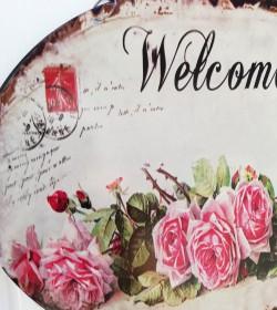 Ovalt skilt med roser og...